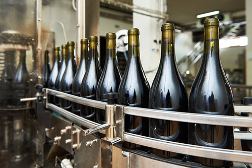 Bottles on conveyor